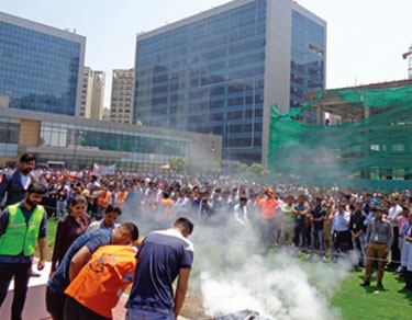 Fire extinguisher operation by employees in Assembly area - Candor TechSpace
