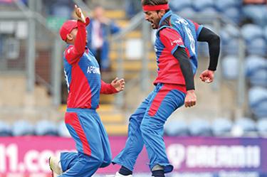Hamid Hasan of Afghanistan celebrates taking the wicket of Dhananjaya de Silva of Sri Lanka during the Afghanistan vs. Sri Lanka match