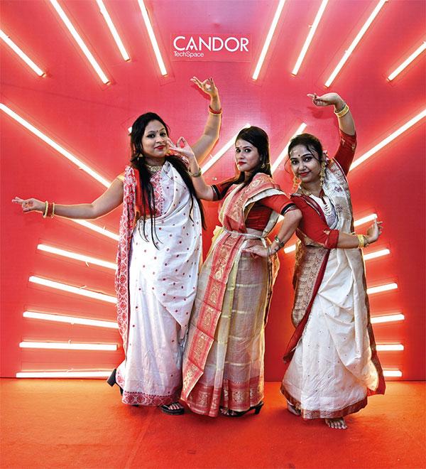 Guests wearing traditional Bengali saris - Candor TechSpace