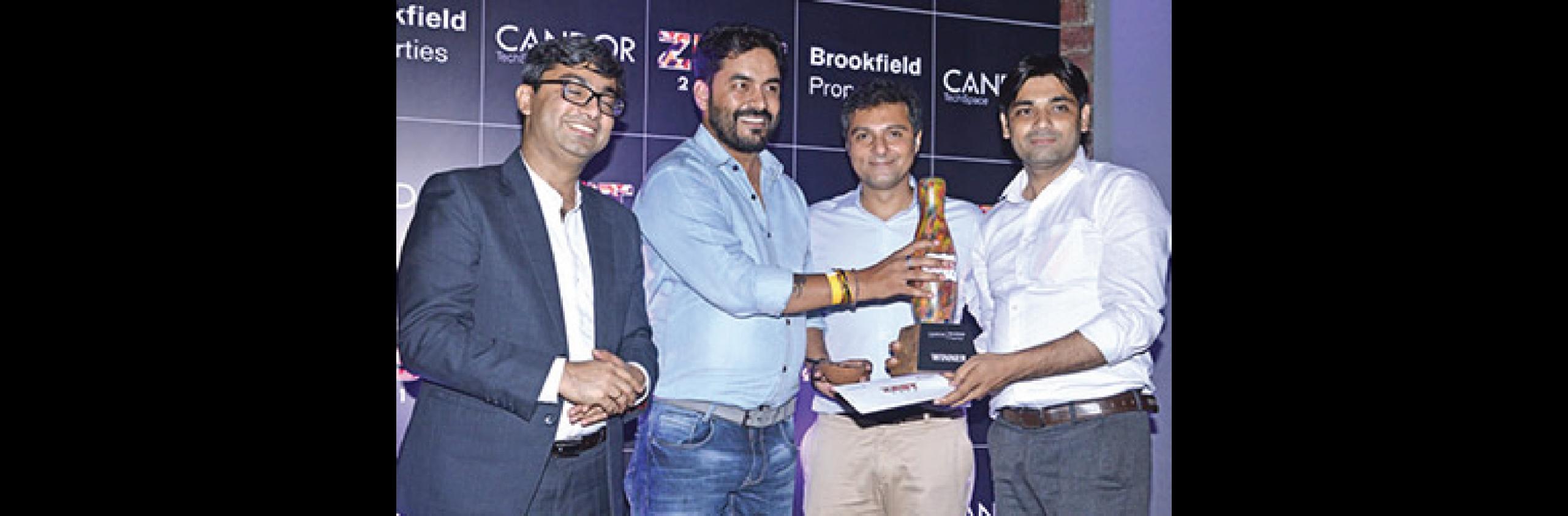 A winning team being felicitated - Candor TechSpace